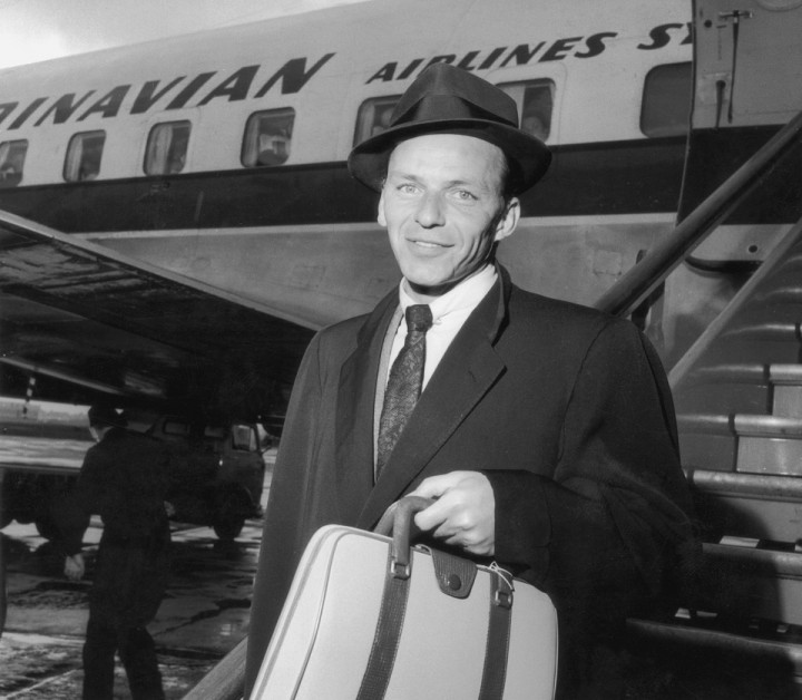 13th April 1956: Frank Sinatra (1915 - 1998), American singer and film star, arriving at an airport. (Photo by Hulton Archive/Getty Images)